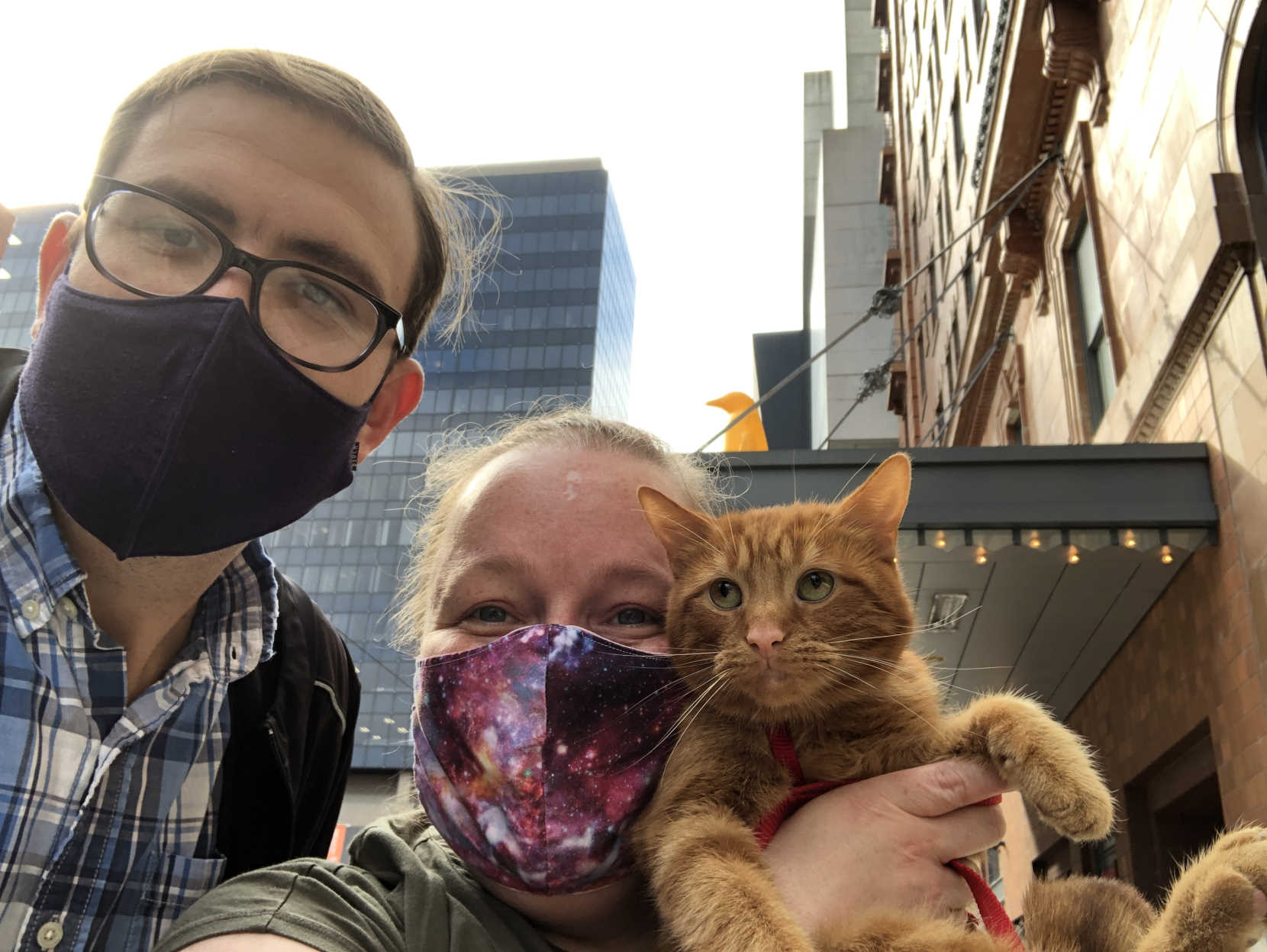 Paul, Amy, and Maxwell the cat in front of the 21c Hotel Cincinnati.