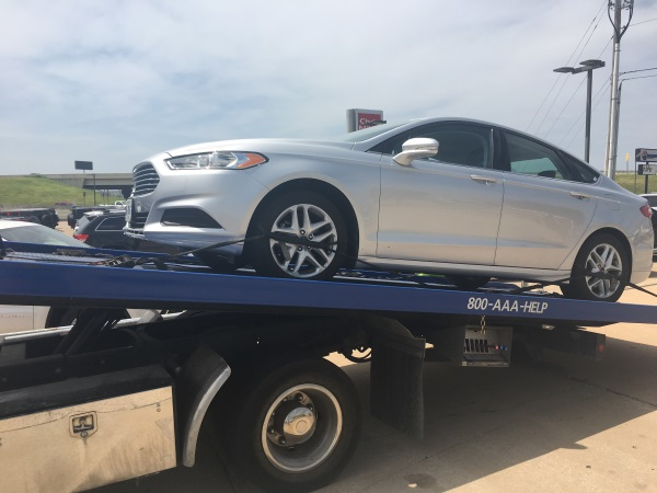 Rental car on a tow truck.